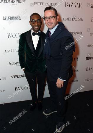 Audemars Piguet CEO Francois-Henry Bennahmias and singer Tinie Tempah attend Harper's Bazaar Women of the Year Awards 2013 at Claridge's Hotel, in London