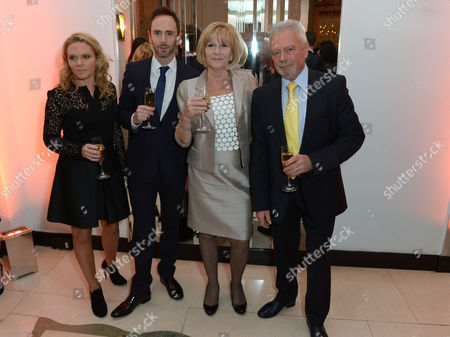 From left to right, Victoria Beckham's sister Louise Adams, brother Christian Adams, and her parents, mother Jacqueline Adams and father Anthony Adams, attend Harper's Bazaar Women of the Year Awards 2013 at Claridge's Hotel, in London