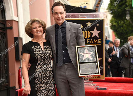 Jim Parsons, right, and Judy Parsons, pose on stage as the actor is honored with a star at the Hollywood Walk of Fame, in Los Angeles