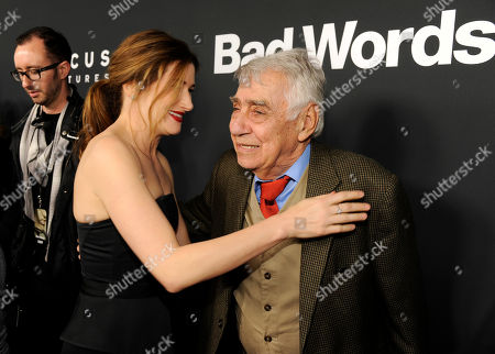 "Kathryn Hahn, left, a cast member in ""Bad Words,"" mingles with fellow cast member Philip Baker Hall at the premiere of the film on in Los Angeles"