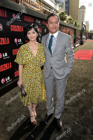 "Kaho Minami, left, and Ken Watanabe arrive at the LA Premiere of ""Godzilla"" at the Dolby Theatre, in Los Angeles"