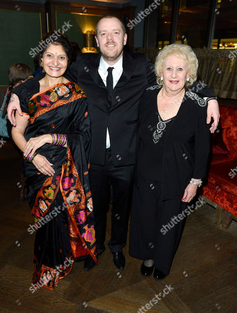 Denise Reuben, Paul Andrew Williams, Taru Devani poses at London Film Festival The Mayfair Hotel Gala - Song for Marion After Party at The Mayfair Hotel on in London