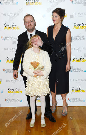 Paul Andrew Williams, Orla Hill, Gemma Arterton poses at London Film Festival The Mayfair Hotel Gala - Song for Marion at Odeon West End on in London