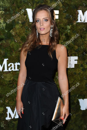 Alex Merrell arrives at a cocktail reception honoring the 2015 Women in Film Max Mara Face of the Future recipient Kate Mara at Chateau Marmont, in West Hollywood, Calif