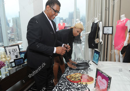 Reality TV star couple NeNe and Gregg Leakes look at Valentine's Day gifts from Sears and Kmart during the Shop Your Way Personal Shopper launch in New York
