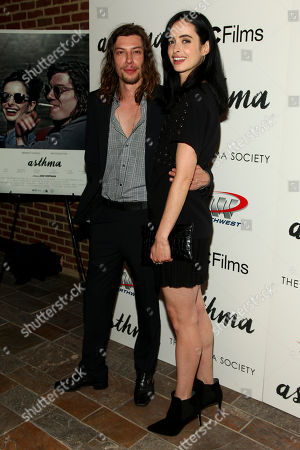 "Benedict Samuel, left, and Krysten Ritter, right, attend a special screening of ""Asthma"", hosted by IFC Films with The Cinema Society, at The Roxy Hotel, in New York"