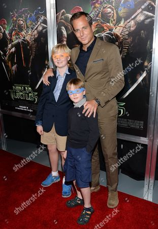 "Actor Will Arnett arrives with sons Abel Arnett and Archibald Arnett attend a special screening of ""Teenage Mutant Ninja Turtles"" at the AMC Lincoln Square, in New York"