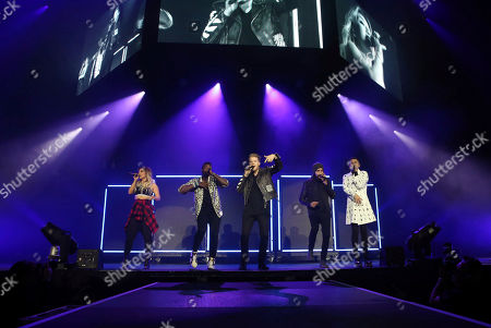 Scott Hoying, Mitchell Grassi, Kirstin Maldonado, Avi Kaplan and Kevin Olusola with Pentatonix performs at the Infinite Energy Arena, in Atlanta