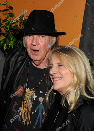 Honoree Neil Young, left, and Pegi Young attend the Producers and Engineers of The Academy's 7th Annual Grammy Week Event, at The Village Recording Studios, on in West Los Angeles, Calif