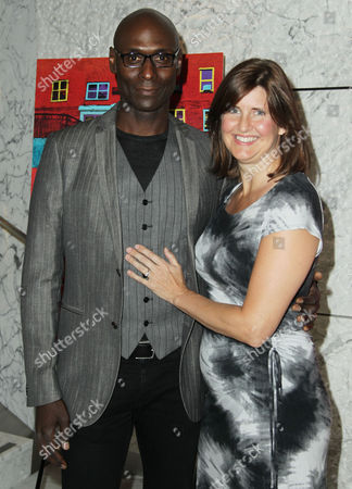 """Lance Reddick, left, and Stephanie Reddick attend the premiere of """"Red Hook Summer"""" at the Ray Kurtzman Theater at Creative Artists Agency, in Los Angeles. """"Red Hook Summer"""" is currently in theaters in New York and expands nationwide on Aug 24, 2012"""