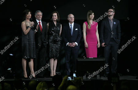 From left, Julie Chen, Les Moonves, Marie-Josee Kravis, Henry Kravis, Jessica Biel and Justin Timberlake appear on stage during the Robin Hood Benefit Concert on in New York