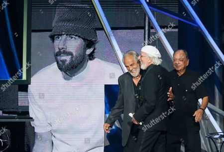 """Tommy Chong, left, and Richard """"Cheech"""" Marin, right, introduce producer Lou Adler (C) as Adler is inducted into the Rock and Roll Hall of Fame during the Rock and Roll Hall of Fame Induction Ceremony at the Nokia Theatre on in Los Angeles"""