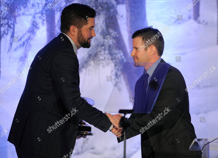 """Director Drew Goddard, left, accepts the Filmmaker's Showcase Award from director Richard Kelly at The Saturn Awards at the Castaway Event Center, in Burbank, Calif. The annual event honors the best in science fiction, fantasy, horror and """"genre"""" films and television shows"""