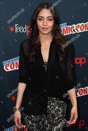 """Carolina Guerra, from """"Da Vinci's Demons"""", poses for photos during the STARZ press line at New York Comic Con on in New York"""