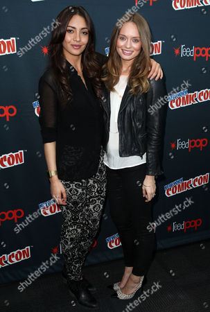 """Laura Haddock, right, and Carolina Guerra, from """"Da Vinci's Demons"""", pose for photos during the STARZ press line at New York Comic Con on in New York"""