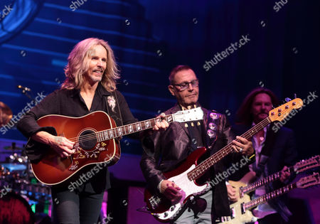 Tommy Shaw, from left, Chuck Panozzo and Ricky Phillips of the band Styx perform in concert at the American Music Theater, in Lancaster, Pa