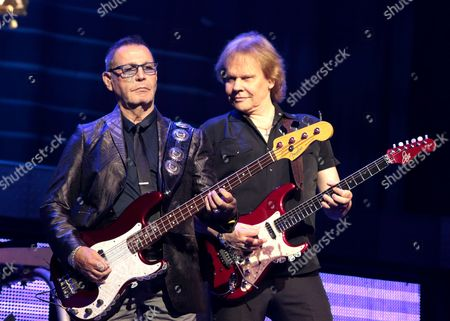 """Chuck Panozzo, from left, and James """"J.Y."""" Young of the band Styx perform in concert at the American Music Theater, in Lancaster, Pa"""