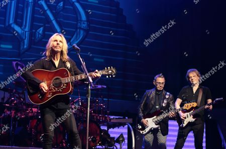 """Stock Photo of Tommy Shaw, from left, Chuck Panozzo and James """"J.Y."""" Young of the band Styx perform in concert at the American Music Theater, in Lancaster, Pa"""