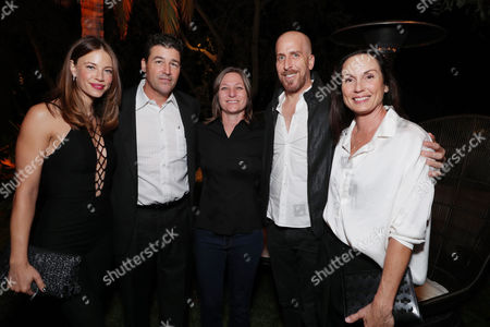 Kyle Chandler, Cindy Holland, Todd Kessler and Kathryn Chandler seen at Ted Sarandos' Annual Netflix Emmy Nominee Toast, in Los Angeles, CA