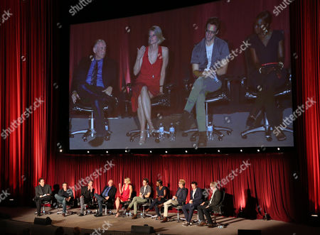 """Tom O'Neil, and from left, Timothy Olyphant Walton Goggins, Nick Searcy, Joelle Carter, Jacob Pitts, Erica Tazel, Jere Burns, Dave Andron, and Fred Golan participate in a panel at """"An Evening with Justified,"""", at the Television Academy in the NoHo Arts District in Los Angeles"""
