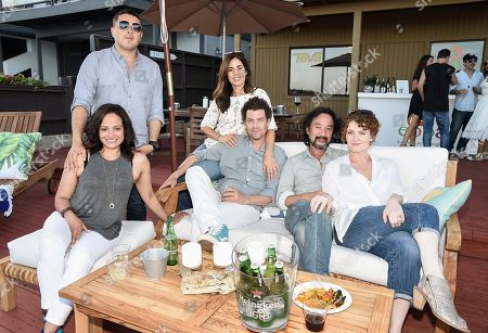 From left to right, actress Judy Reyes and her husband, actress Ana Ortiz and her husband, and actress Rebecca Wisocky and her husband at the Kia Malibu Beach House Presented by Teva on in Malibu, Calif. Martinez, Wisocky and Reyes later live tweeted an episode of their television show Devious Maids