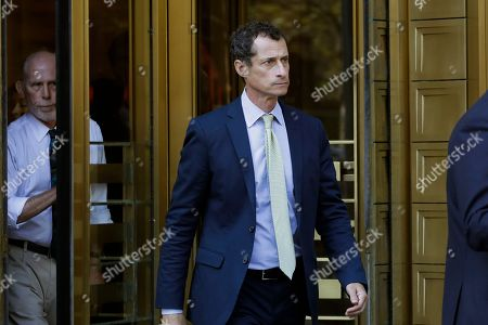 Stock Picture of Former Congressman Anthony Weiner (D-N.Y.), right, leaves federal court following his sentencing, in New York. Weiner was sentenced to 21 months in a sexting case that rocked the presidential race
