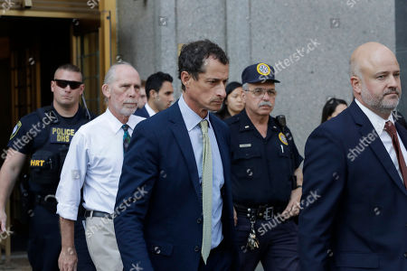 Former Congressman Anthony Weiner (D-N.Y.), center, leaves federal court following his sentencing, in New York. Weiner was sentenced to 21 months in a sexting case that rocked the presidential race