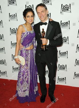 Stock Image of Aparna Danna, left, and Mychael Danna arrive at the Twentieth Century Fox & Fox Searchlight Pictures Oscar Party at the LURE on in Los Angeles