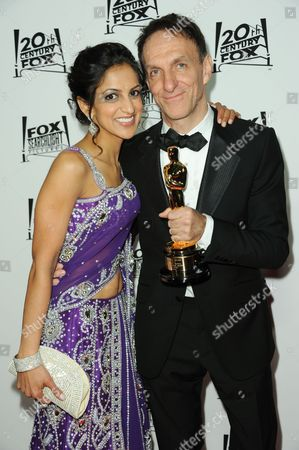 Aparna Danna, left, and Mychael Danna arrive at the Twentieth Century Fox & Fox Searchlight Pictures Oscar Party at the LURE on in Los Angeles
