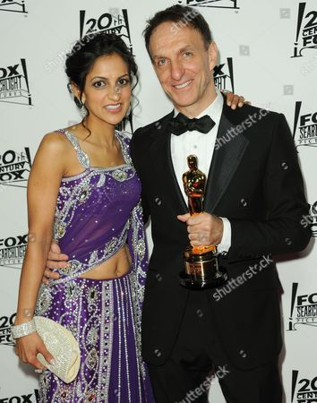 Stock Picture of Aparna Danna, left, and Mychael Danna arrive at the Twentieth Century Fox & Fox Searchlight Pictures Oscar Party at the LURE on in Los Angeles