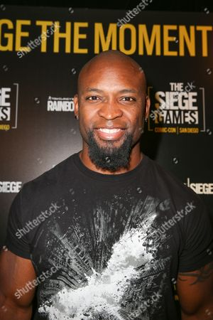 Stock Picture of Ahman Green poses after playing Tom Clancy's Rainbow Six Siege at the Ubisoft event during Comic-Con, in San Diego, Calif