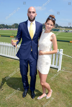 Drummond Money-Coutts and guest attend the Veuve Clicquot Gold Cup Polo Final at Cowdray Park, West Sussex, on
