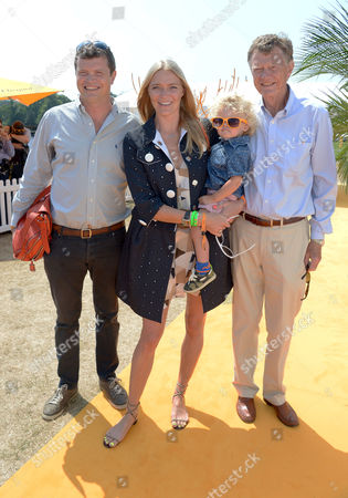 Jack Kidd, Jodie Kidd, Son Indio and dad Johnny Kidd attend the Veuve Clicquot Gold Cup Polo Final at Cowdray Park, West Sussex, on