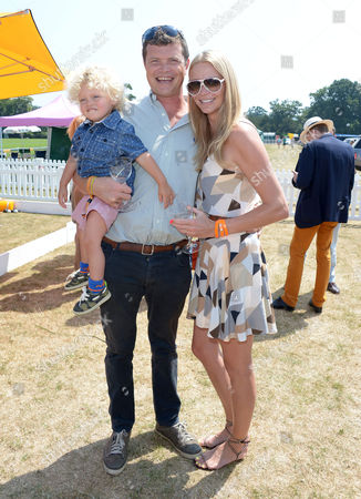 Stock Image of Jack Kidd, Jodie Kidd and her son Indio attend the Veuve Clicquot Gold Cup Polo Final at Cowdray Park, West Sussex, on