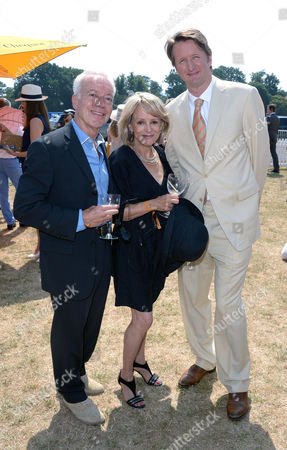 Stock Photo of Nickolas Grace, Clare Francis and Tom Hooper attend the Veuve Clicquot Gold Cup Polo Final at Cowdray Park, West Sussex, on