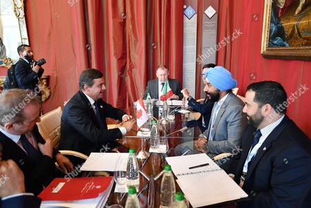 Stock Image of Italian Economic Development Minister, Carlo Calenda and Canadian Minister of Innovation, Science and Economic Navdeep Singh Bains (R) during the G7 ICT (Information and communication technologies) and Industry Ministers' Meeting at Venaria' Reggia in Turin, Italy, 25 September 2017.