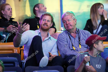 Stock Picture of Prince Harry (L) and Sir Keith Mills attend powerlifting finals during the Invictus Games 2017 at Mattamy Athletics Centre