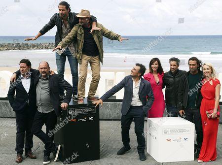 Spanish film director Antonio Cuadri (C) and actors Jordi Molla (2-R), Karra Elejalde (2-L), Unax Ugalde (3-R), Barbara Mori (R), Alosian Vivancos (3-L), Ramon Agirre (4-R) and Barbara Goenaga (4-R), and Producer Joxe Portela (L) pose for the media during the presentation of the film 'Operacion Concha' at the San Sebastian International Film Festival, in San Sebastian, Spain, 25 September 2017. The San Sebastian International Film Festival runs from from 22 to 30 September.
