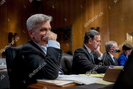 Bill Cassidy, Rick Santorum. Senator Bill Cassidy, R-La., left, and Former PennsySenatoria Sen. Rick Santorum, second from left, appear before a Senate Finance Committee hearing to consider the Graham-Cassidy healthcare proposal, on Capitol Hill, in Washington