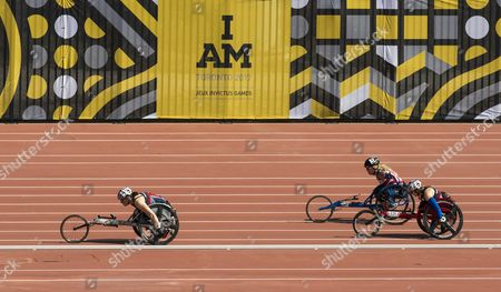 Stock Photo of (L-R) British Jen Warren, US Brandi Evans and  British Lindsay Chapman  compete in the Women's 1500m IT4/IT5 Wheelchair Run during the Athletic events of the third Invictus Games in Toronto, Canada, 25 September 2017. The eight-day event, established in 2014 by Prince Harry, includes over 550 injured soldiers and veterans from 17 countries competing in 12 adaptive sports.