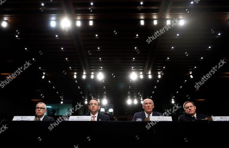 """Andrew McCabe, Rod Rosenstein, Dan Coats, Mike Rogers. From left, Acting FBI Director Andrew McCabe, Deputy Attorney General Rod Rosenstein, National Intelligence Director Dan Coats, and National Security Agency Director Adm. Michael Rogers are seated during a Senate Intelligence Committee hearing about the Foreign Intelligence Surveillance Act on Capitol Hill in Washington. Intelligence and law enforcement officials across the government lobbied Congress on Monday, Sept. 25, to let them conduct broad surveillance on foreign targets in coming years, saying it helps prevent terrorist and cyberattacks on the United States. Coats said getting the highly contentious section of the Foreign Intelligence Surveillance Act renewed is his """"top priority this year"""