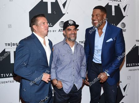 """Christopher Long, Gotham Chopra, Michael Strahan. Head of audience network at AT&T Christopher Long, left, author Gotham Chopra and television personality Michael Strahan attend a special screening of """"Religion of Sports"""" during the Tribeca TV Festival at Cinepolis Chelsea at, in New York"""