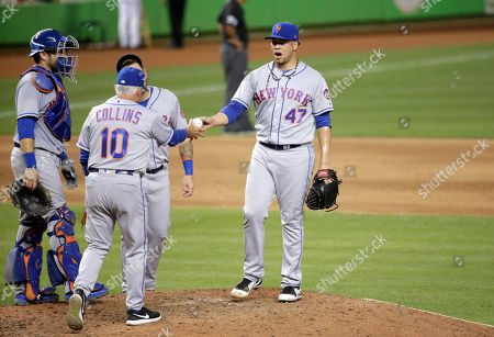 Terry Collins, Hansel Robles. New York Mets relief pitcher Hansel Robles (47) hands the ball to manager Terry Collins (10) after being relieved during a baseball game against the Miami Marlins, in Miami. The Marlins won 13-1