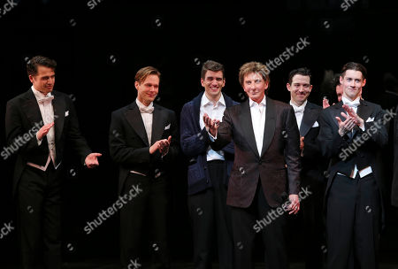 "From left, cast members Douglas Williams, Will Taylor, Shayne Kennon, Composer Barry Manilow and cast members Matt Bailey, Will Blum (obscured) and Chris Dwan cheer during the curtain call after the opening night performance of ""Harmony"" at Center Theatre Group/Ahmanson Theatre, in Los Angeles, Calif"