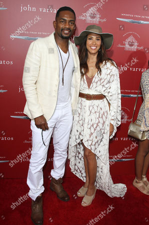 Bill Bellamy, left, and Kristen Baker Bellamy arrive at the 13th annual Stuart House benefit at John Varvatos Boutique, in West Hollywood, Calif