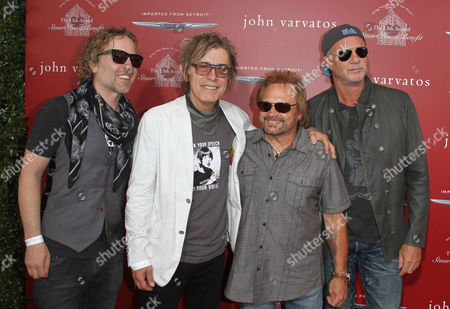 Daxx Nielsen, from left, Tom Petersson, Michael Anthony and Chad Smith arrives at the 13th annual Stuart House benefit at John Varvatos Boutique, in West Hollywood, Calif