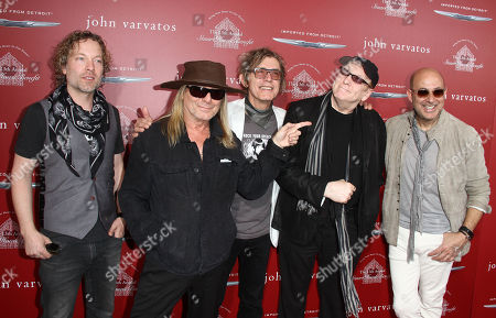 Daxx Nielsen, from left, Robin Zander, Tom Petersson and Rick Nielsen of Cheap Trick pose with John Varvatos, right, at the 13th annual Stuart House benefit at John Varvatos Boutique, in West Hollywood, Calif