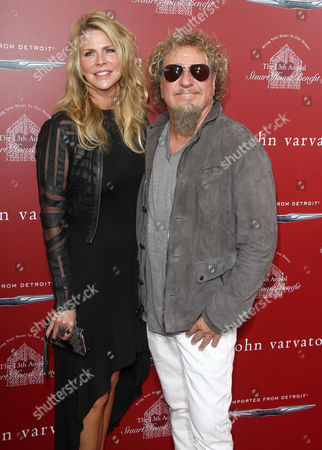 Kari Karte, left and Sammy Hagar arrive at the 13th annual Stuart House benefit at John Varvatos Boutique, in West Hollywood, Calif