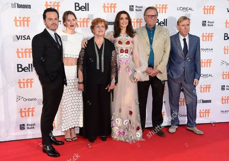 """Andrew Scott, from left, Caren Pistorius, Deborah Lipstadt, Rachel Weisz, Tom Wilkinson and Timothy Spall arrive at the """"Denial"""" premiere on day 4 of the Toronto International Film Festival at the Princess of Wales Theatre, in Toronto"""