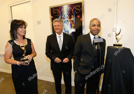 Colleen Williams, left, Chuck Henry, center, are seen backstage at the Television Academy's 66th Los Angeles Area Emmy Awards on at The Leonard H. Goldenson Theater in the NoHo Arts District in Los Angeles